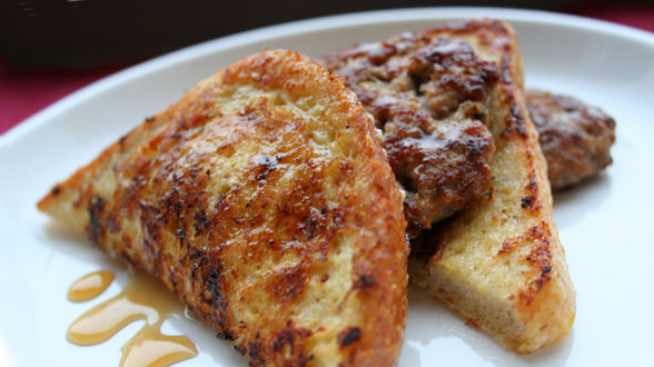 Black Pepper Parmesan Reggiano French Toast with Italian Sausage Patties and Warm Honey