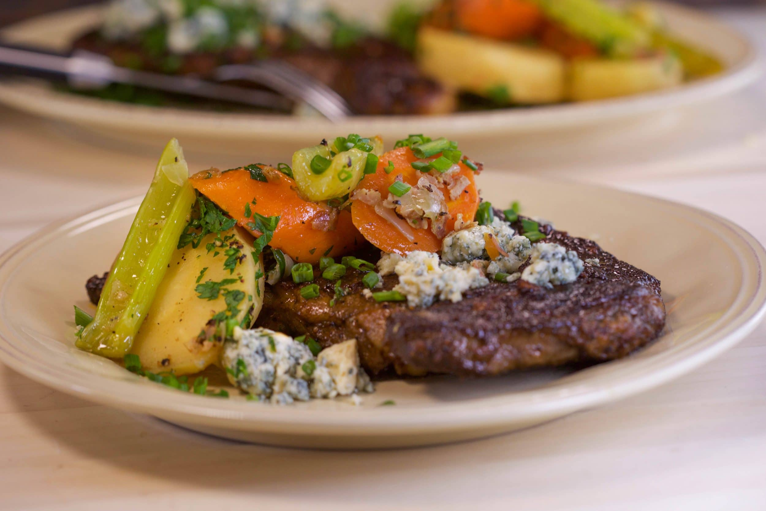 Buffalo Steaks with Braised Celery, Carrots and Parsnips