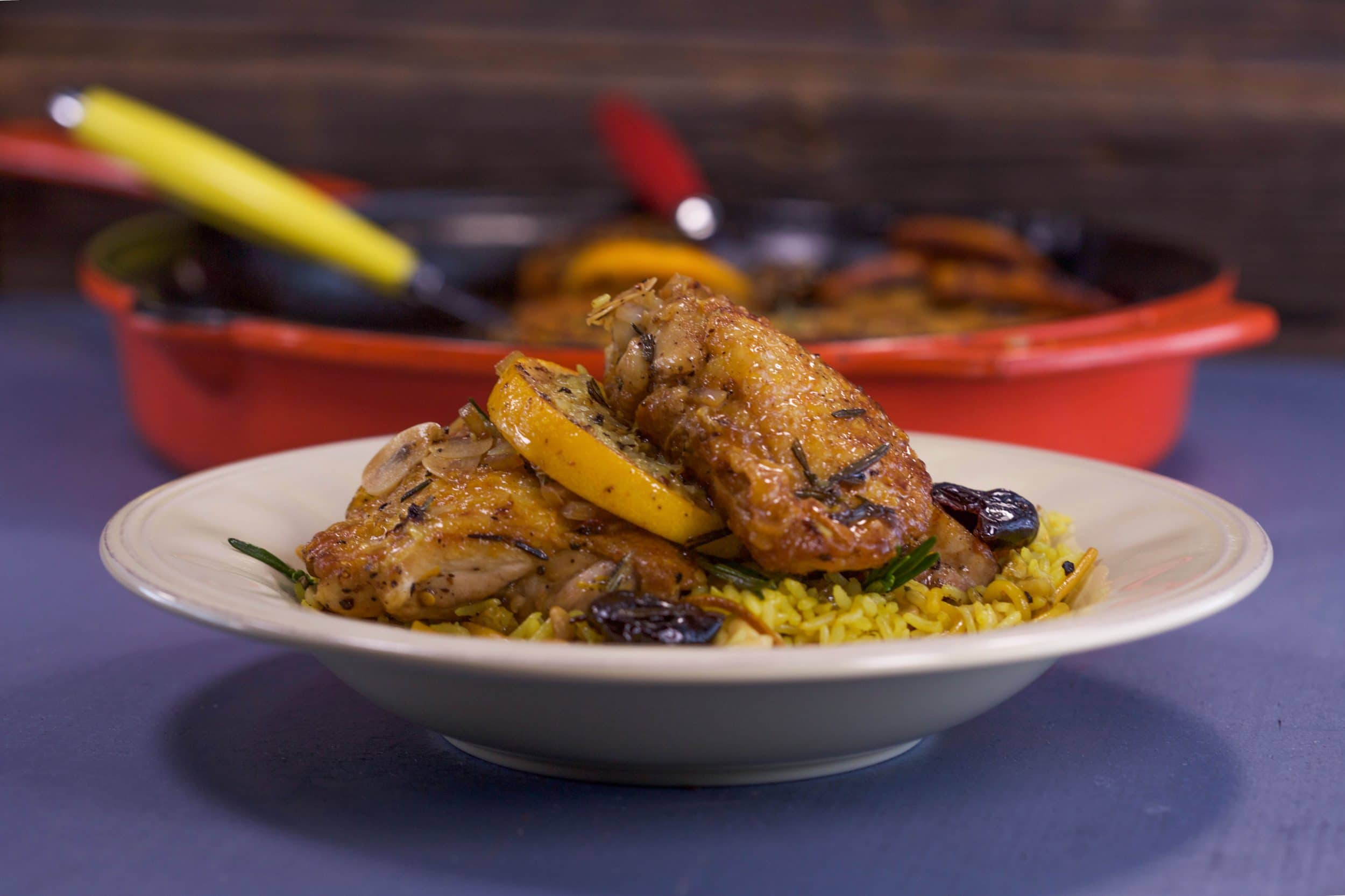 Chicken Thighs with Orange and Rosemary, and Saffron Rice with Pine Nuts and Golden Raisins