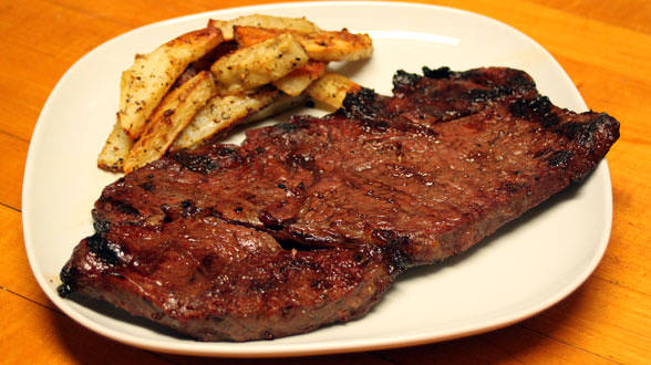 Drunken Steaks with Twice-Baked Peppercorn Fries