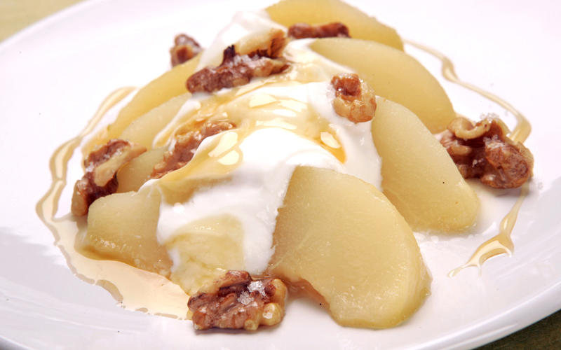 Honey-poached pear with Greek yogurt and toasted walnuts