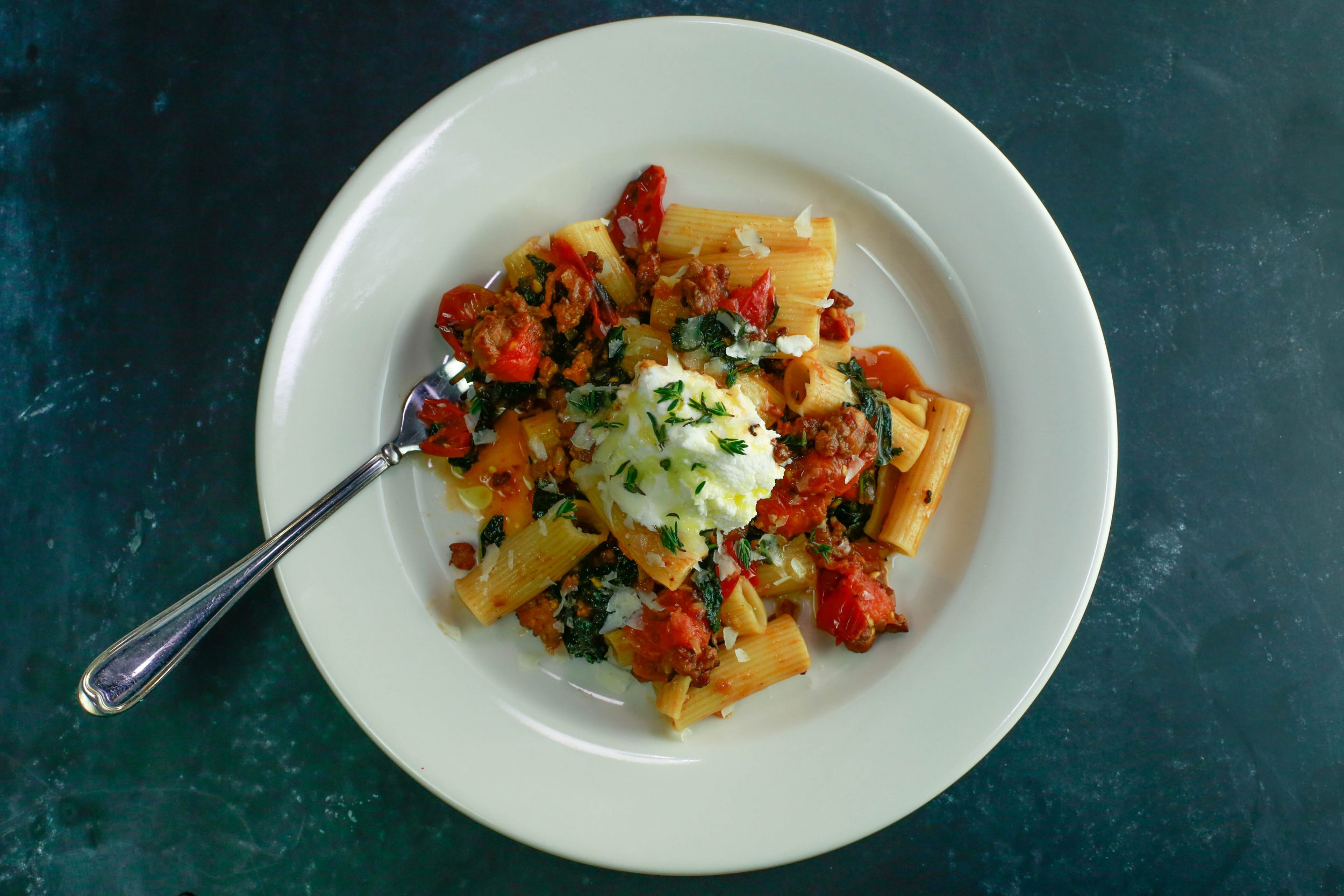 Riggies with Charred Tomatoes, Hot Sausage, Kale and Ricotta