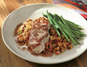 Spanish Pork Chops with Linguica Corn Stuffing and Wine Gravy