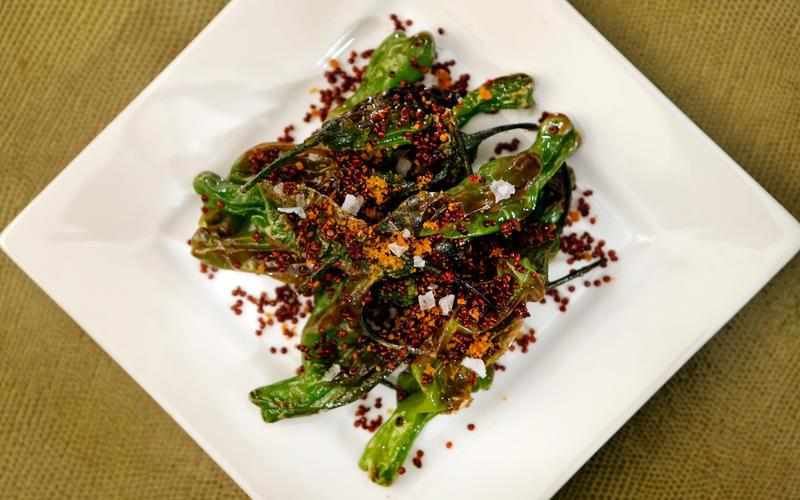 Spicy shishitos with crispy quinoa