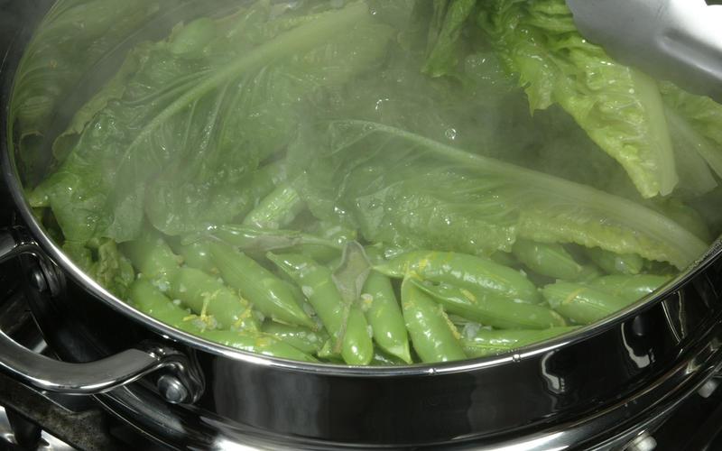 Sugar snap peas steamed in lettuce leaves