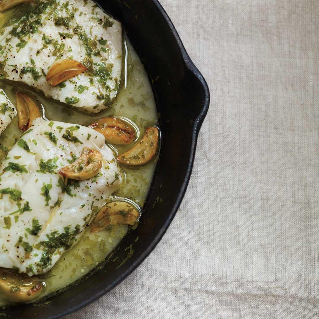 Baked Garlic Cod on a bed of Wilted Pesto Spinach